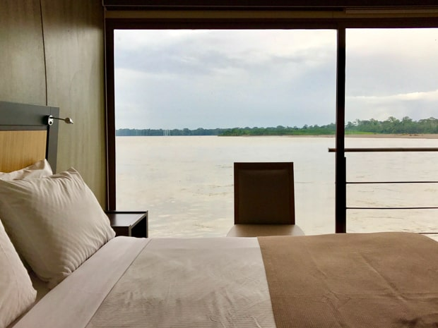 View of the Ecuadorian Amazon river from the bedroom aboard the Anakonda.