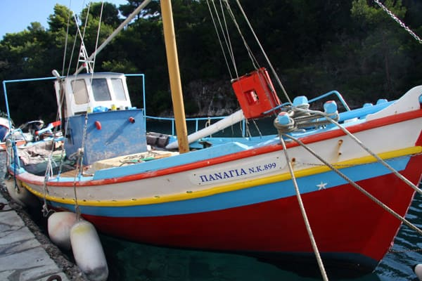 Colorful fishing boat in Paxos, Greece.