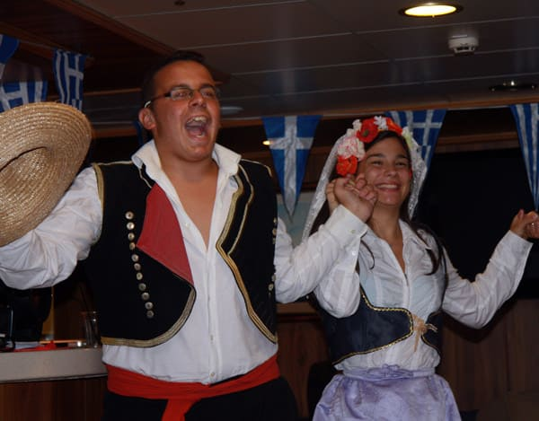 Greek Dancing in traditional clothes aboard small ship cruise in Adriatic.