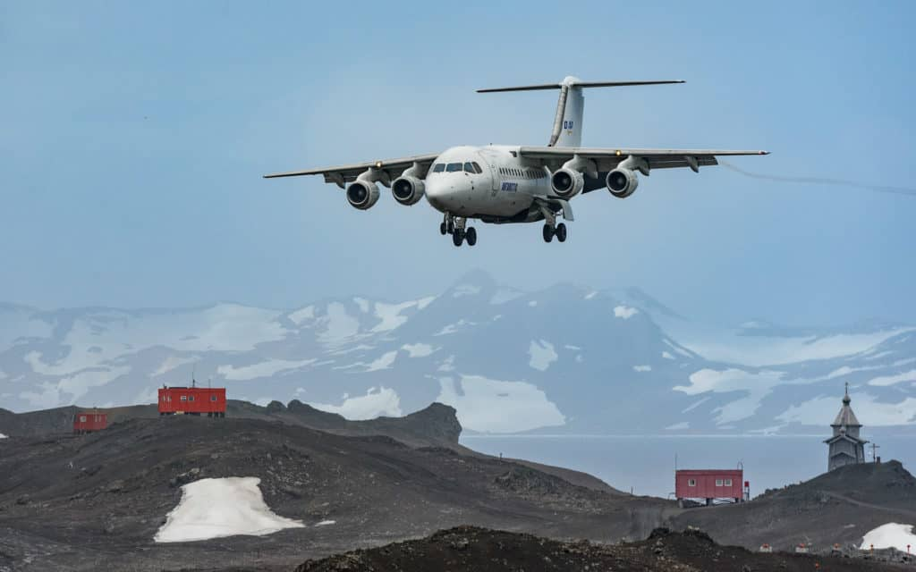 an airplane lands on a strip in antarctica