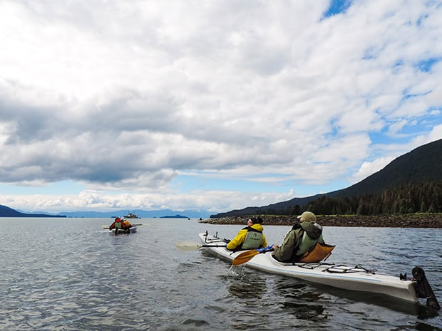 People kayaking on an excursion in Alaska.