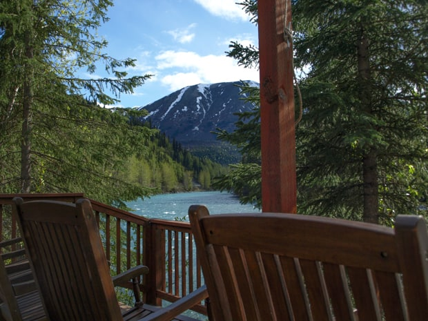 A scenic view from the deck of a Alaskan Wilderness lodge overlooking the Kenai River and forest.