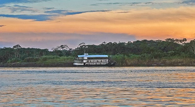 The Amatista river boat docked on the shore of the Peruvian Amazon river.