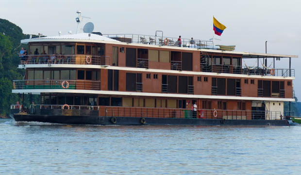 The Anakonda small ship motoring up the Ecuadorian Amazon river.