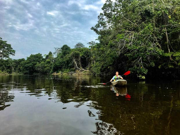 A man kayaking on the Ecuadorian Amazon jungle.