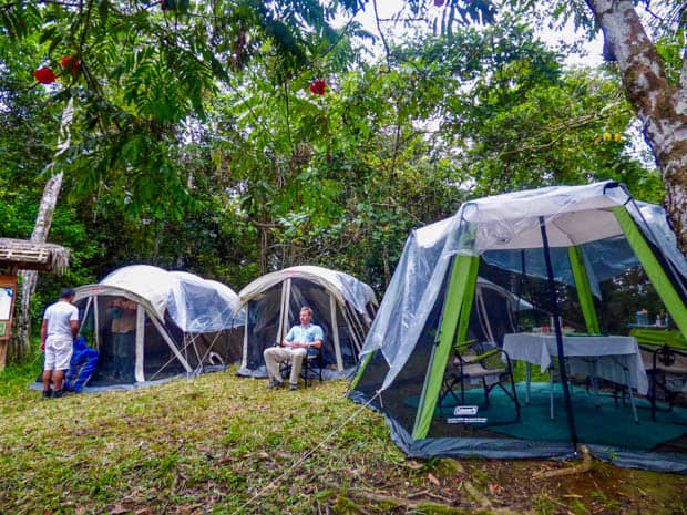 A man and crew glamping in the Ecuadorian Amazon jungle.
