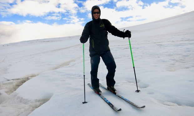 Happy guest from a small ship cruise to Antarctica cross country skiing.