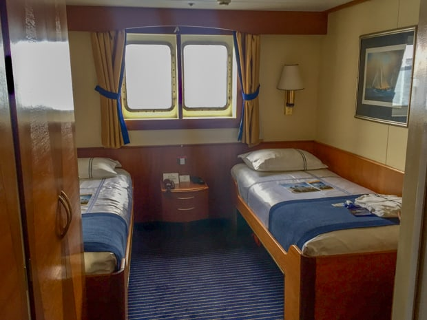 Twin window cabin aboard the small ship Ocean Adventurer.