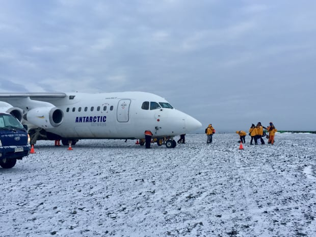 Guests disembarking plane that landed on Antarctica.