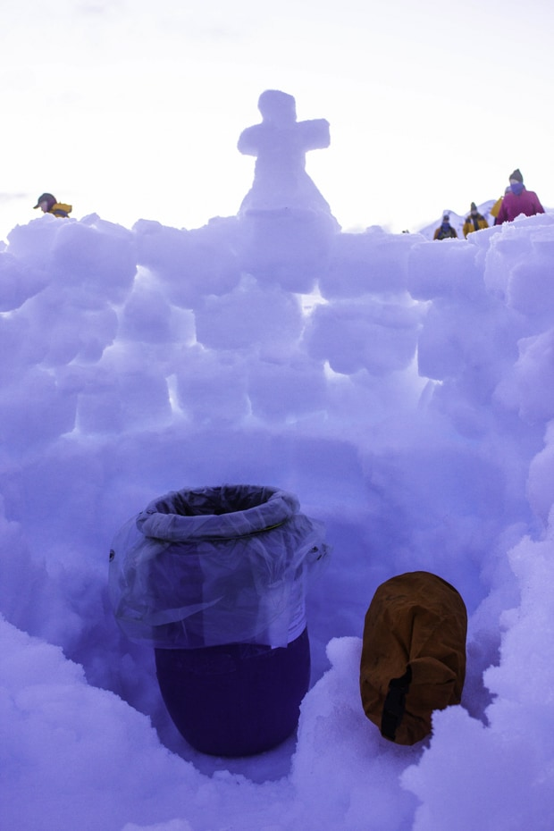Plastic lined container as a toilet with a wall of snow around it for privacy, used on a camping excursion in Antarctica.