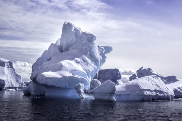 Unique shaped icebergs and different shades of blue as seen from a small ship cruise in Antarctica.