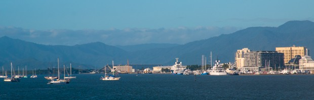 The Cairns waterfront with ships and sailboats.