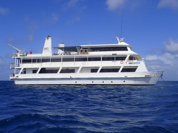An image of the Coral Expedition II in Australia with three decks and white hull.
