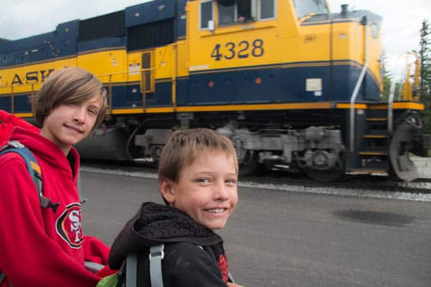 Two boys waiting to board the Alaska Railroad train.
