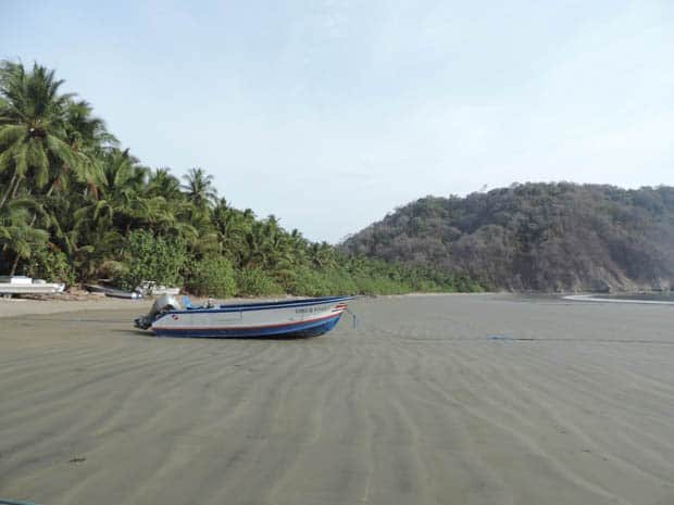 Lone small boat on a beach in Costa Rica.