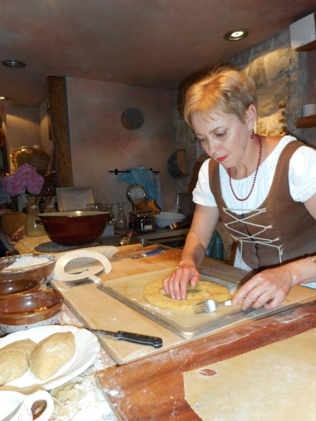 Croatian woman making bread in a kitchen.