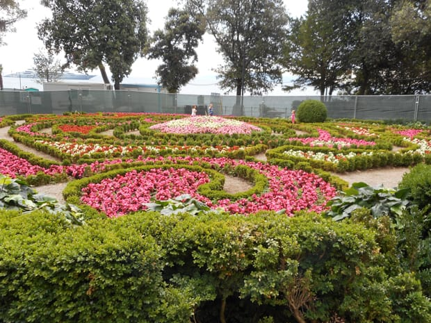 Colorful circular and swirled gardens of green, pink, white and red.