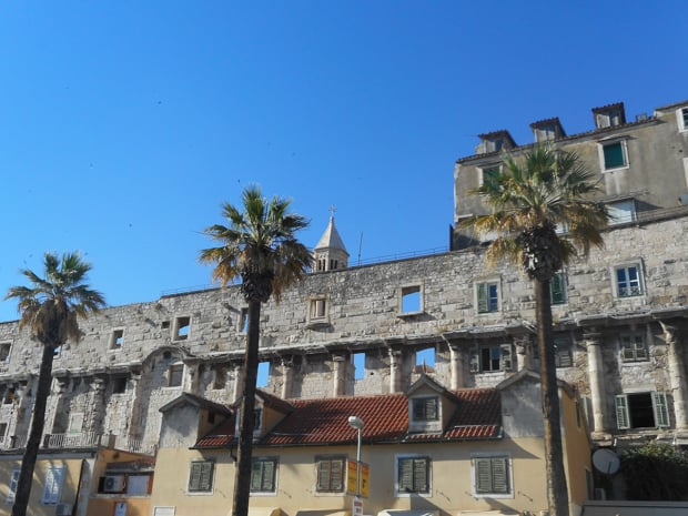 Old stone walls of a building with tower steeple in Dubrovnik, Croatia.