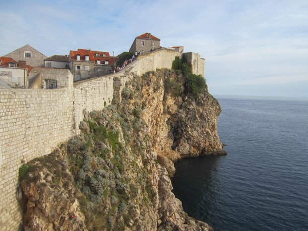 View while walking along Dubvrovnik's fortress walls of the town on one side and the cliffs over the ocean on the other.