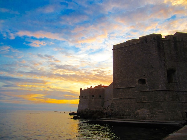 Sunset behind the fortress walls of Dubrovnik Croatia, seen from a small ship cruise.