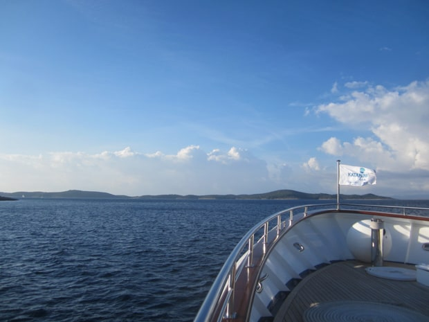 View of Croatia in the distance seen from the bow of a small ship cruise.
