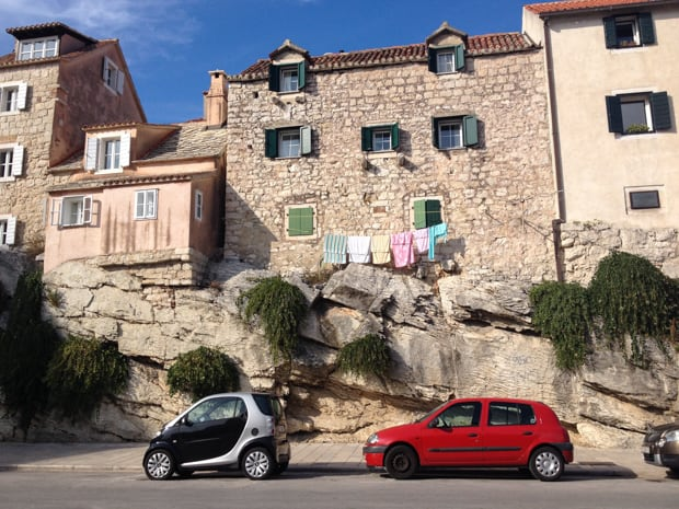 Small village in Croatia with the houses hanging their laundry outside on a clothesline.