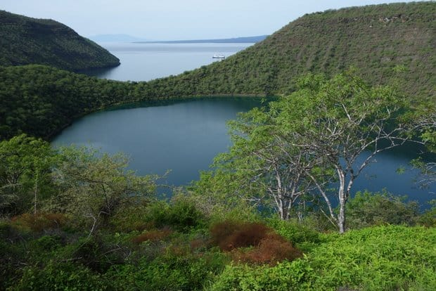 A lake hidden behind a narrow peninsula on a Galapagos island.