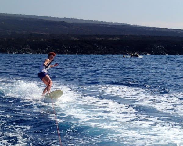 Hawaiian cruise skurfing behind the skiff