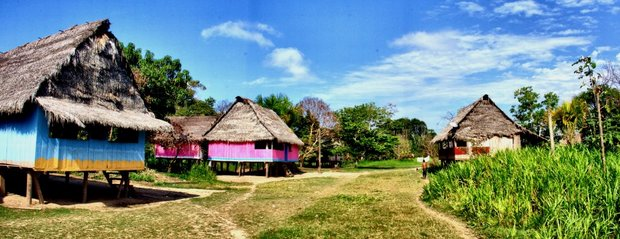 Bright colored stilt houses in a village in Peru.