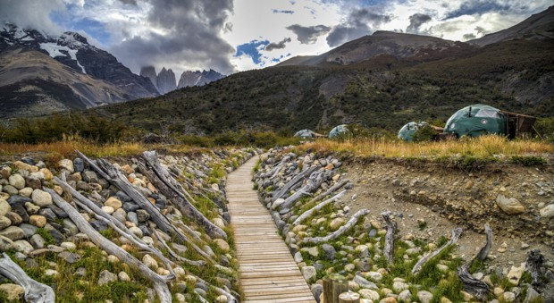 View of the boardwalk to a group of dome EcoBase camps on the valley floor in Patagonia's Torres del Paine National Park.