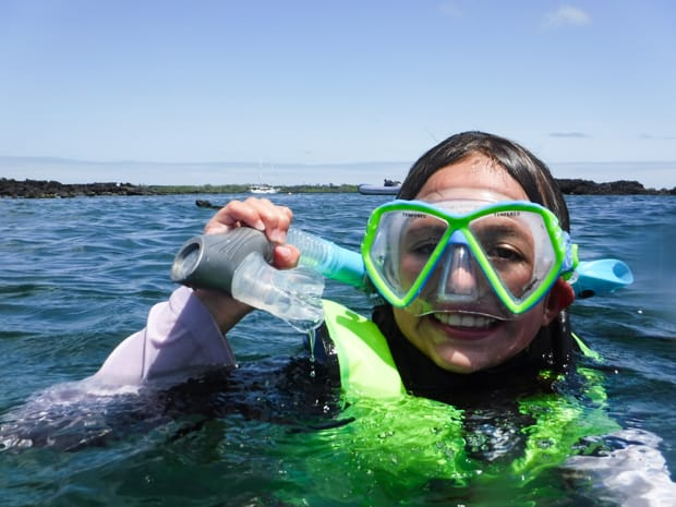 A young girl snorkeling in the Galapagos
