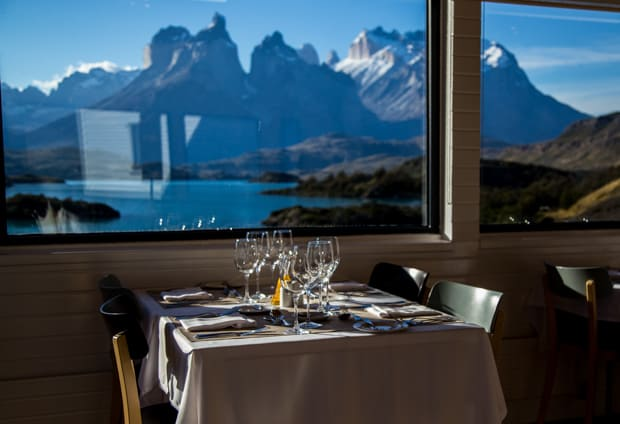 Panoramic view of Lake Pehoe and mountains from the dining room at Explora Lodge.