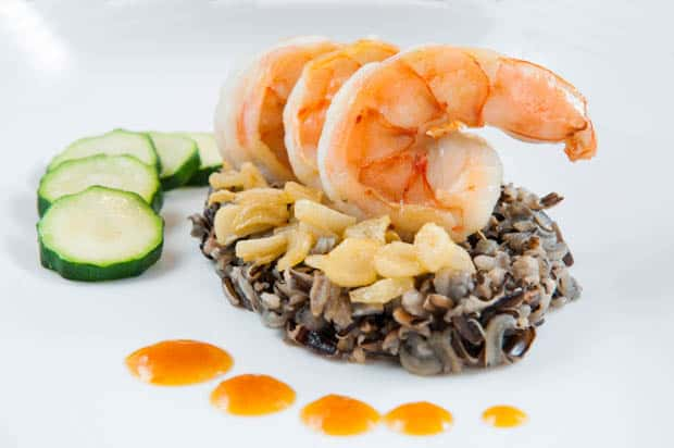 Prawn dish with wild rice and zucchini.
