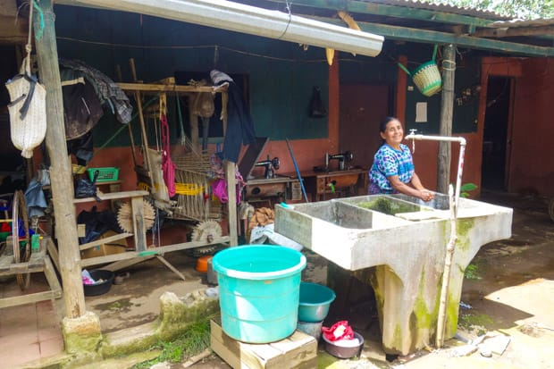 A local Guatemalan woman's home with sewing machines, weaving materials.