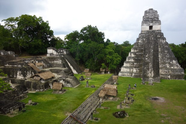 Tikal Mayan ruin of stone temples and a grassy courtyard.