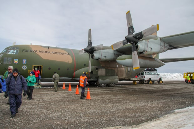 Guests boarding a Lockheed C130 Hercules aircraft in Punta Arenas Chile.