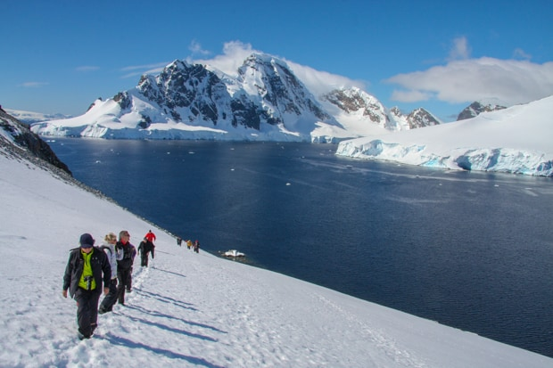 Guests hiking in Antarctica on the snow.