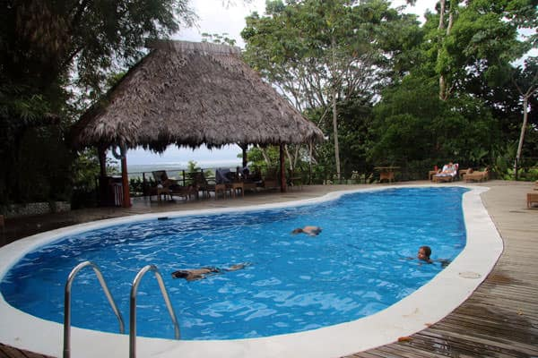 Young travelers playing in a pool at a Costa Rican Lodge.