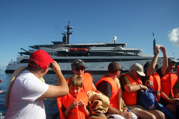 Guests on a skiff in front of their small ship Costa Rica and Panama cruise.