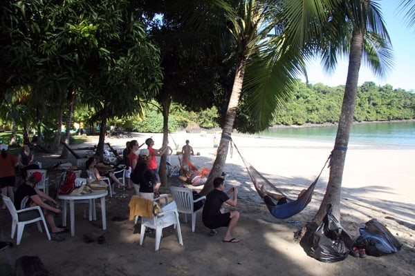 Guests from a small ship Costa Rica and Panama cruise relaxing at a beach on Coiba Island.