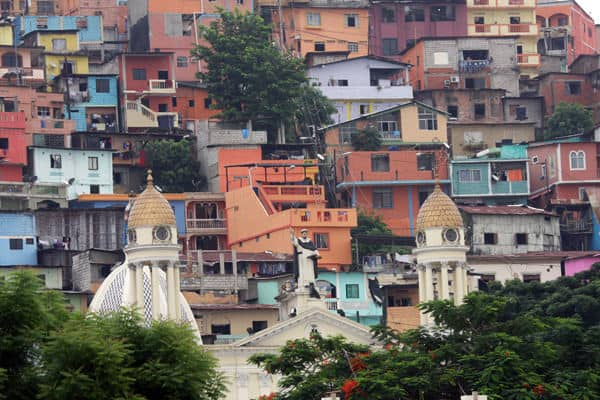 Colorful buildings with a cathedral in the center in Guayaquil.