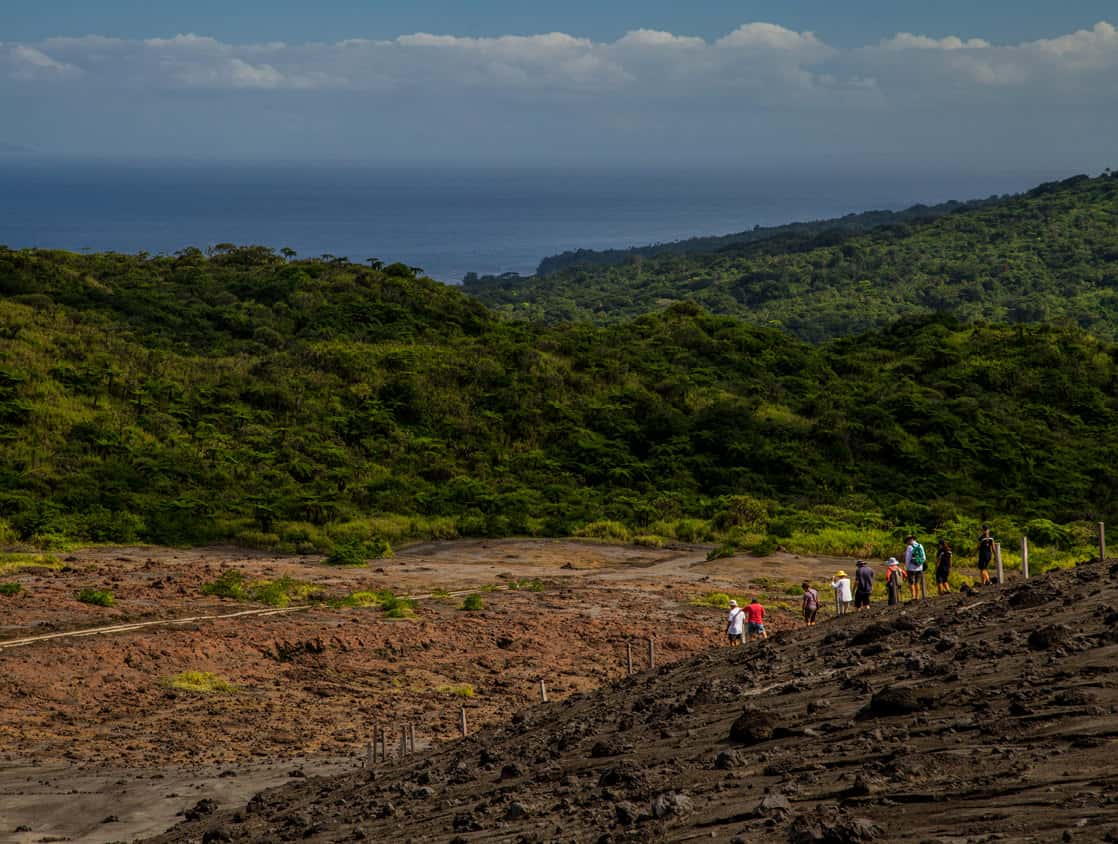 Guests from a small ship cruise hiking on an island in the south pacific.