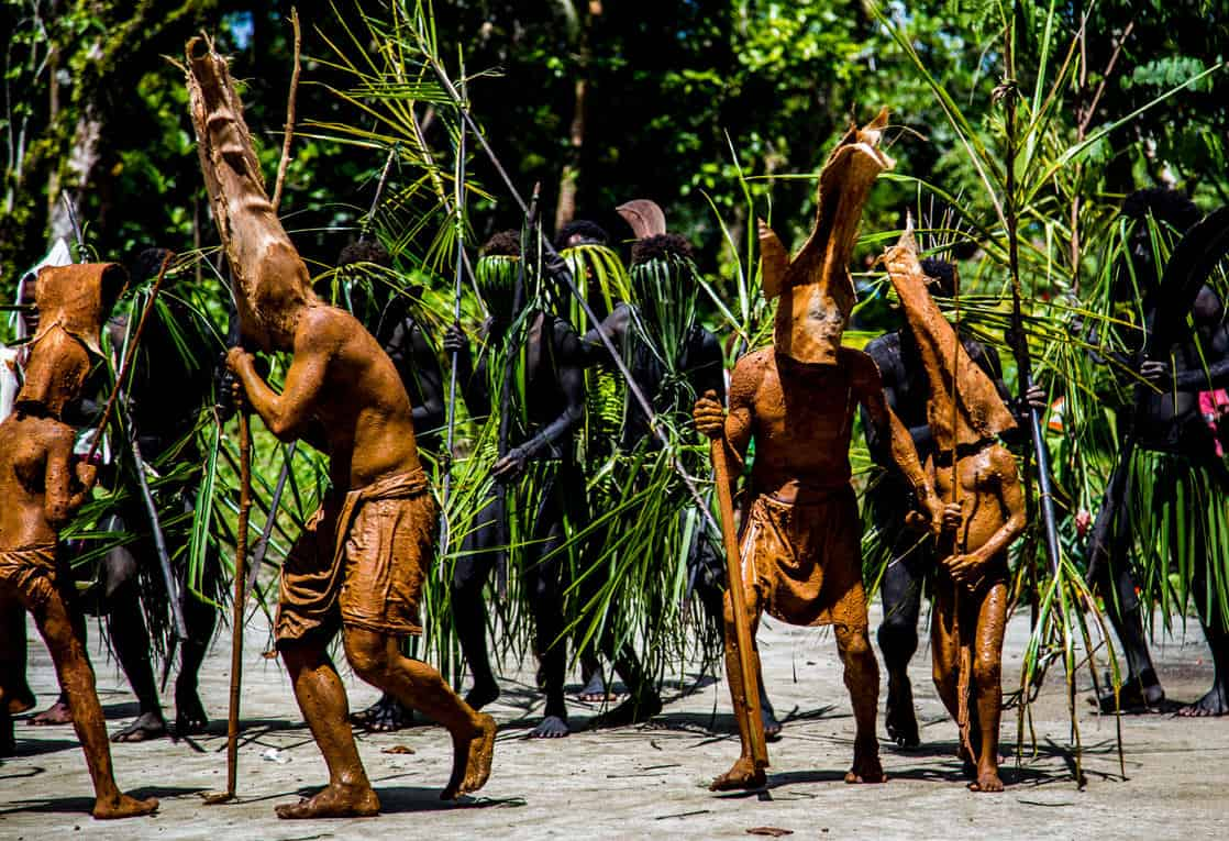 Locals performing a mud dance seen from a small ship cruise in the south pacific islands.