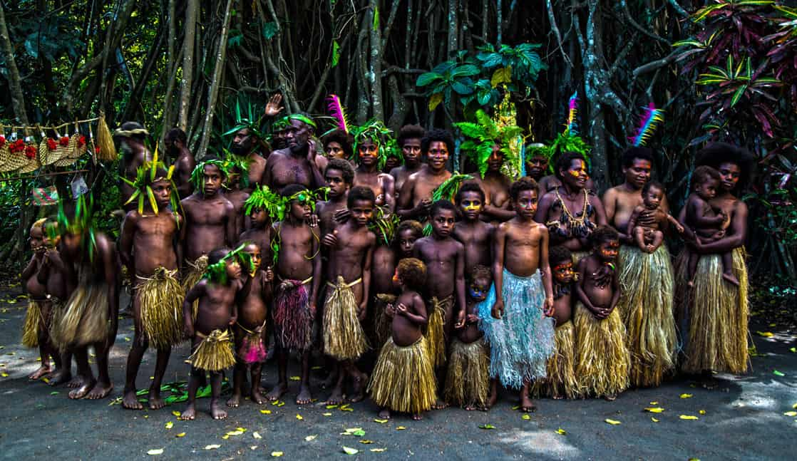 Local group of villagers in the South Pacific seen from a small cruise ship excursion.