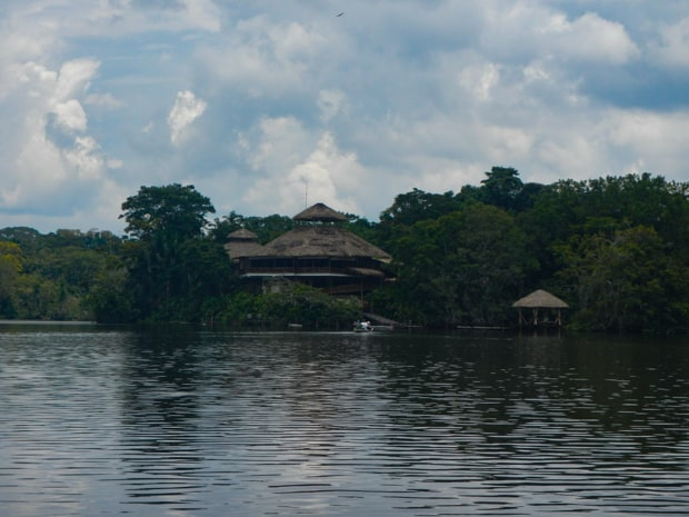 View from the water of the La Selva Lodge on the shoreline of the Amazon jungle.