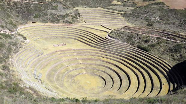 Ancient terraced stone ruin on a Peruvian land tour.