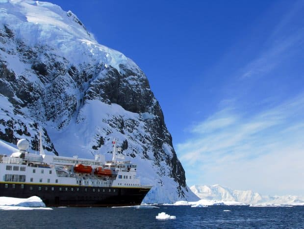 Small expedition cruise ship near land in Antarctica.
