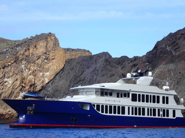 Close up look at the small ship cruise Origin anchored off the coast of the Galapagos.