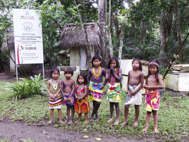 Local children from a village in the Darien Jungle greeting guests on tour from their small ship cruise in Panama.