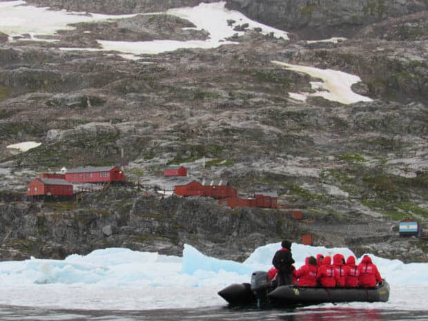 Group aboard a skiff from their small ship heading to a research station in Antarctica.